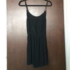 Black Indah Dress XS Indah clothing black dress worn once. Cinches at the waist and has adjustable straps. Made of crepe material. Fits an XS-S best. Only worn once! Indah Dresses Mini