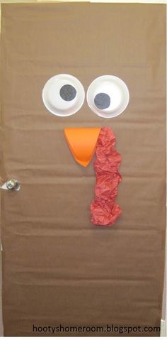 Turkey Classroom Door {It doesn't get much easier than this!} Use styrofoam bowls for the eyes, construction paper for the beak, and scrunch up some red paper for the gobble!