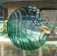 Handmade Round Stained Glass Suncatcher with glass bubbles and pearlized Turbo shell. $35.00, via Etsy.