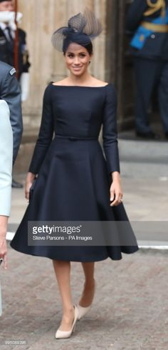 The Duchess of Sussex leaves a service at Westminster Abbey, London, to mark the centenary of the Royal Air Force. (Photo by Steve Parsons/PA Images via Getty Images)
