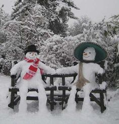 snow people on garden bench