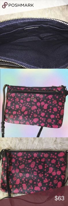 Brand New Limited Floral Coach Crossbody Purse Brand New Limited Floral Coach Crossbody Purse.  Only worn a couple times and I take good care of my purses so its in great condition and looks unused.  Beautiful pink/red flower print. Strap has adjustable buckle. Comes with a wallet.  Pretty purse but I never use it. Retails for over $100. Coach Bags Crossbody Bags