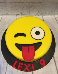 Emoji cake . Rainbow swirl vanilla cake with buttercream filling, ganache and fondant casing.