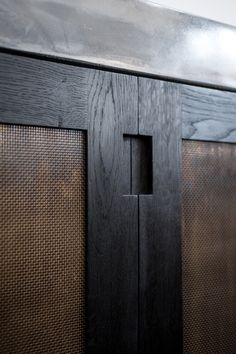 patinated brass mesh and wood