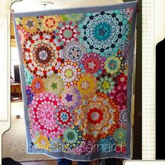 Millefiori quilt. Holy moly. It's all EPP and fussy cut. Simply AMAZING.