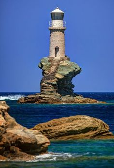 10 of the world's most eccentric lighthouses Rising from a precarious chunk of sea rock off the coast of Andros, Greece, the Tourlitis Lighthouse is so whimsical and surreal that it almost looks Photoshopped. Lighthouse Pictures, Beacon Of Light, Water Tower, Beautiful Places, Wonderful Places, Scenery, To Go, Around The Worlds, Amazing