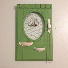 Jewelry holder/organizer made out of an old cabinet door. diy. upcycled. repurposed