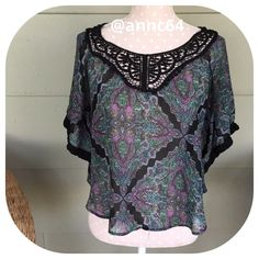 Speechless Poncho Black, purples and green with lace makes this an awesome top. Speechless Tops
