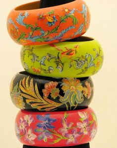 Decoupage bracelets needed wide bracelets, some beautiful gift wrap paper, some modpoge and a steady cutting arm.