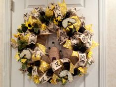 Bumble bee favorite things party wreath! See more party planning ideas at CatchMyParty.com!