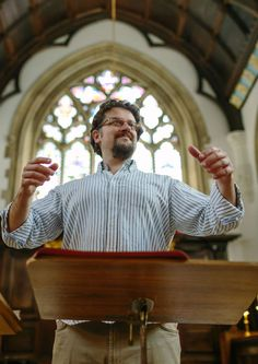 Giles Underwood, Univ's Director of Music, conducting the choir in the chapel.