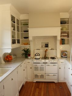 There is so much to love in this kitchen the drawer pulls the latches on the doors the floor the back splash. even the supports for the top cabninets. love those too. Small Kitchens Design, Pictures, Remodel, Decor and Ideas - page 4