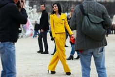 "vogue-tales: "" exhalevogue: "" Her black hair and the yellow is beautiful…"
