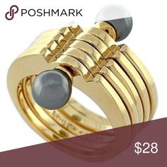 Louise et Cie Faux Pearl Stacked Ring NWOT Darkly lustrous faux pearls stud this statement-making ring crafted from stacks of 14k gold-plated bands for a modern, pre-layered look. NWOT Louise et Cie Jewelry Rings