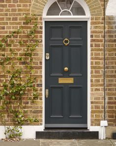 A Victorian door in a dark matte finish, brass door furniture and a robust locking system. Victorian doors are made from a choice of hardwood timbers – in particular, the specially treated Accoya®. Yellow Front Doors, Front Door Colors, Victorian Front Doors, Victorian Homes, Victorian Porch, Victorian Cottage, Modern Victorian, 6 Panel Doors, Front Door Makeover