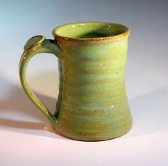 Pottery Coffee Mug by LaurenBauschOriginal....... I have one like this with the thumb hold and I love it!!