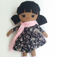 This sweet girl doll is handmade with love! She has a lovely cappuccino skin colour. She is wearing a black and pink floral dress with a removable skirt and a pink scarf. She is wearing pink patterned boots that are made from cotton. Her hair is done in two pigtails and is made from black wool felt. I stuffed her with polyfil stuffing. She is very huggable and lovable, and is safe for all ages. This doll measures 18 / 45cm from the top of her head to the tips of her shoes. If she gets di...