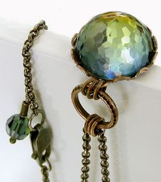 Vintage Swarovski Crystal Pendant ...  This is a rare, and unusual Swarovski crystal cabochon - a faceted dome and multiple colors radiate out from a rich amber gold at the center, to shades of green out to a lovely ocean blue. The colors look different from every angle