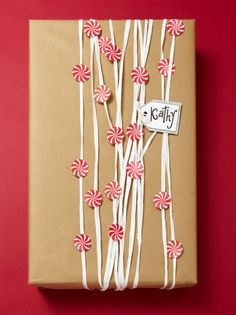 Decorate kraft paper with white raffia and stickers for a super-easy but unique wrap. More easy gift wrap ideas: http://www.midwestliving.com/holidays/christmas/easy-christmas-gift-wrap-ideas/?page=6