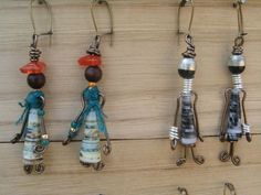 i LOVE THIS IDEA..LADY FIGURES AS JEWELLERY-PAPER & BEADS. I think they'd make nice pins instead of earrings.