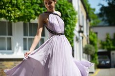 Swinging, spinning and snaking our way into summer. This lilac dress is finished with a hand-beaded snake. The Matthew Williamson Lilac Silk Beaded Snake Dress.