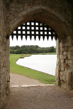 Leeds Castle, Kent, England.  View to the moat from the barbican portcullis. Photo: Richard Croft