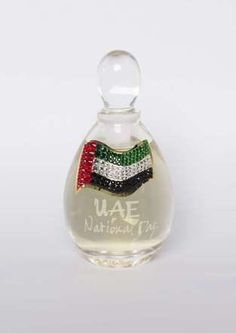 Swarovski-encrusted UAE National Day bottle, filled with the fragrance of your choice, M.Micallef  #UAENationalDay #UAE #nationalday #dubai #abudhabi