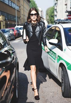 An all black look is finished off with a statement necklace and cool sunglasses