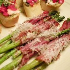 Asparagus Wrapped in Crisp Prosciutto | Extremely easy and elegant appetizer. Asparagus spears are wrapped in a sheath of prosciutto, then baked until crispy. A great dish to make ahead, and bake just before serving