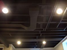 unfinished basement ideas low ceiling 24 Ways to Make a Basement Ceiling Look Higher Unfinished Basement Ceiling, Basement Ceiling Options, Industrial Basement, Basement Lighting, Ceiling Ideas, Basement Ceilings, Ceiling Lighting, Basement Black Ceiling, Dark Ceiling