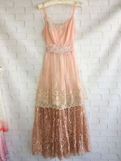 One of a kind.   The top of the dress is hand dyed rose gold with beaded alancon lace appliqués, adjustable straps, and it zips up back. The skirt has two layers. The underlayer is two kinds of lace. The top layer is tea stained soft mesh tulle with embroidery. Lace sash has embroidered beaded appliqués. Size medium Measurements Bust 36 Waist 30 Length 54