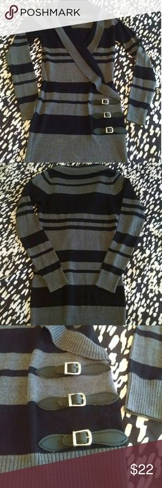 Long Striped Sweater w/ Faux Buckles - Never Worn! This black and gray sweater has a cross over front and faux buckles. It is long, so it looks so cute with leggings and black boots! It has never been worn and is looking for a good home! Sweaters