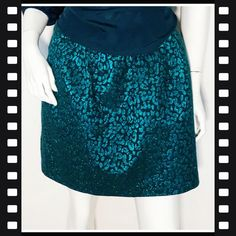 9de6acc4d7 Size 12 metallic jade green and black a-line skirt with pockets. Mid thigh.  Depop