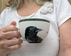 Hand-painted Raven Coffee Cup ~ via this Etsy store,  	 KneeDeepOriginals