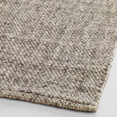 Handmade of natural felted wool, our Light Gray Emilie Flatweave Sweater Wool Area Rug boasts a thick texture that feels…