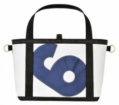 The Yacht Club Tote is the perfect beach tote for those hot summer days. Made exclusively from recycled yacht sails