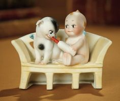 """Bread and Roses - Auction - July 26, 2016: 157 Rare German Bisque Vignette """"Kewpie on Bench with Doodledog"""""""