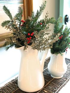 Faux evergreen, eucalyptus stems, and berry branches are all you need to get the look of this classic holiday arrangement. Grab a bunch of each material and slip it into a clean white pitcher to finish. No watering or maintenance required. Christmas Tabletop, Coastal Christmas, Christmas Table Decorations, Country Christmas, Simple Christmas, Christmas Home, Christmas Holidays, Holiday Decor, Christmas Floral Arrangements