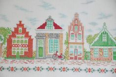 Product Description: Houses in Amsterdam - this is a iconic piece for Dutch cross stitch , perfectly made, but old, the fabric is showing wear on