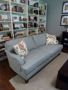 Shelving behind couch