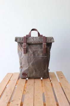 Waxed Canvas Backpack Roll top with brown leather details, Waxed Canvas Rucksack Roll top, olive green by Phestyn on Etsy https://www.etsy.com/listing/237742410/waxed-canvas-backpack-roll-top-with