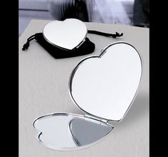 Heart Shaped Mirror.  Creative heart-shaped chrome compact mirrors.