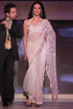 Shop online at http://www.satyapaul.com/satyapaul/shop/bridal-wear/bridal-sarees/esw1764 and visit us at http://www.facebook.com/SatyaPaulIndia