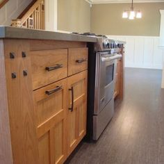 Craftsman Kitchen - love the metal detail on left & the stairs in the background