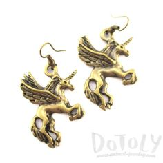 A pair of super cute animal themed dangle earrings featuring Pegasus unicorn shaped charms in brass! More animal jewelry available online! Unicorn Jewelry, Horse Jewelry, Animal Jewelry, Unicorn Horse, Super Cute Animals, Pegasus, Dangle Earrings, Dangles, Lion Sculpture