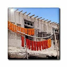 """Afghanistan, Ghazni, Dyed wool textiles on poles -AS01 RER0062 - Ric Ergenbright - 12 Inch Ceramic Tile by 3dRose. $22.99. Dimensions: 12"""" H x 12"""" W x 1/4"""" D. High gloss finish. Construction grade. Floor installation not recommended.. Image applied to the top surface. Clean with mild detergent. Afghanistan, Ghazni, Dyed wool textiles on poles -AS01 RER0062 - Ric Ergenbright Tile is great for a backsplash, countertop or as an accent. This commercial quality constructio..."""