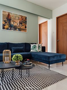 Patterned monochrome rug in a small living room in an affordable housing society Blue Couch Living Room, Living Room Sofa Design, Home Room Design, Living Room Interior, Rugs In Living Room, Living Room Designs, Living Room Decor, Room Rugs, Indian Living Rooms