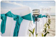 chairs for wedding . . I love it when the chairs are covered and has a pretty bow tied around the back :) beautiful
