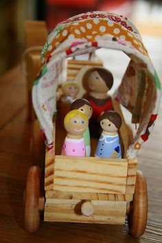 Ingalls family peg dolls in covered wagon toy