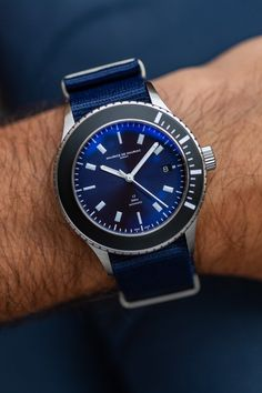Maurice de Mauriac L2 Deep Blue diver watch | Photo: Hodinkee | Design by Fabian Schwaerzler| Automatic Swiss movement (ETA-28.24) stainless steel case | Ø 42 mm closed back|Blue canvas strap | Sapphire crystal with anti-reflective treatment on both sides | Water resistant: 300 meters